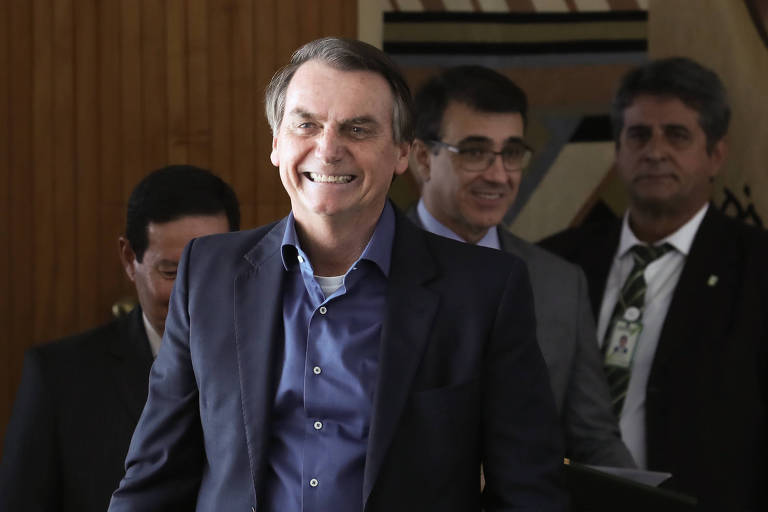 O presidente Jair Bolsonaro durante cerimônia para sancionar lei que altera o estatuto do desarmamento