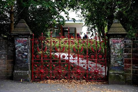 Graffiti is pictured on the posts and the gates to Strawberry Field in Liverpool, northwest England on September 18, 2019. - Beatles fans can now take a trip through the childhood sanctuary of John Lennon that inspired seminal song