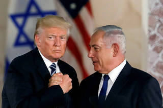 FILE PHOTO: U.S. President Donald Trump and Israeli Prime Minister Benjamin Netanyahu shake hands after Trump's address at the Israel Museum in Jerusalem