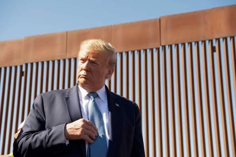 US President Donald Trump visits the US-Mexico border fence in Otay Mesa, California on September 18, 2019. (Photo by Nicholas KAMM / AFP) ORG XMIT: 1672