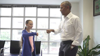 Greta Thunberg and former U.S. President Barack Obama fist bump during a meeting at Obama's personal office in Washington