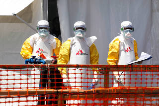 FILE PHOTO: Health workers dressed in protective suits are seen at the newly constructed MSF Ebola treatment centre in Goma