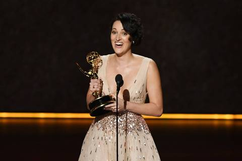 LOS ANGELES, CALIFORNIA - SEPTEMBER 22: Phoebe Waller-Bridge accepts the Outstanding Writing for a Comedy Series award for 'Fleabag' onstage during the 71st Emmy Awards at Microsoft Theater on September 22, 2019 in Los Angeles, California.   Kevin Winter/Getty Images/AFP