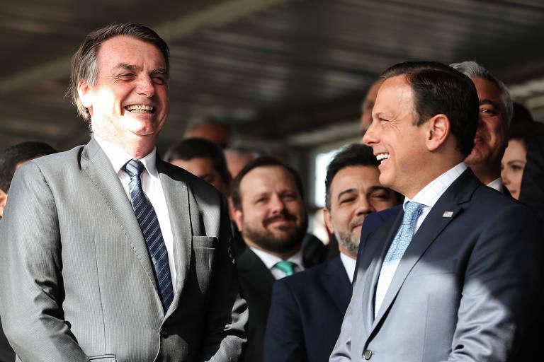 O presidente Jair Bolsonaro e o governador de São Paulo, João Doria, durante a solenidade de Passagem do Comando Militar do Sudeste em julho deste ano