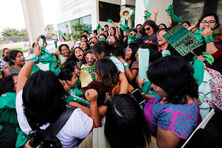 Pro-choice demonstrators celebrate after lawmakers passed a legislation that decriminalizes abortion, outside the local congress in Oaxaca