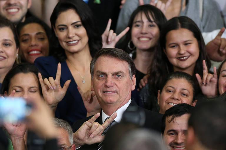O presidente Jair Bolsonaro e a primeira-dama Michelle Bolsonaro durante evento no Palácio do Planalto