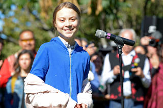 Climate change teen activist Greta Thunberg speaks before joining a climate strike march in Montreal