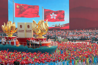 Float featuring ?One country, two systems? policy travels past Tian'anmen Square during a parade marking the 70th anniversary of the founding of the People's Republic of China, on its National Day in Beijing