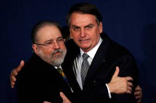 Brazil's President Bolsonaro greets Brazil's new Prosecutor-General Aras during his handover ceremony in Brasilia