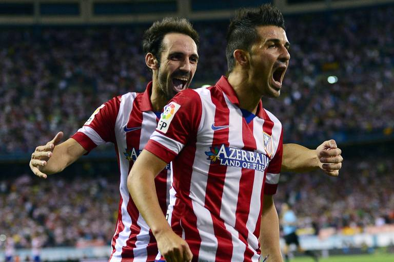 Juanfran celebra gol do Atlético de Madri com o atacante David Villa. Lateral jogou de 2011 a 2019 no clube