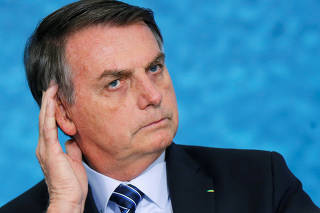 Brazil's President Jair Bolsonaro attends a launch ceremony of the government anti-crime project at the Planalto Palace in Brasilia