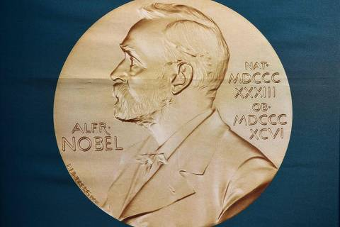 (FILES) In this file photo taken on October 01, 2018 A portrait of Swedish inventor and scholar Alfred Nobel can be seen on a banner on display at the Nobel Forum in Stockholm, Sweden, prior to a press conference to announce the winner of the 2018 Nobel Prize in Physiology or Medicine at the Karolinska Institute in Stockholm, Sweden. (Photo by Jonathan NACKSTRAND / AFP)