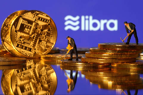 FILE PHOTO: FILE PHOTO: Small toy figures are seen on representations of virtual currency in front of the Libra logo in this illustration picture, June 21, 2019. REUTERS/Dado Ruvic/File Photo ORG XMIT: FW1