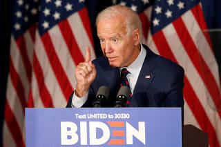 Democratic 2020 U.S. presidential candidate and former Vice President Joe Biden gestures as he speaks at a campaign town hall meeting in Rochester