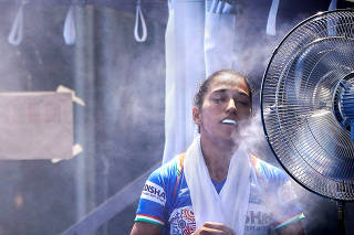 A field hockey player from India cools off with a misting fan during a match on Aug. 17, 2019 in Tokyo, site of the 2020 Summer Olympics. (Chang W. Lee/The New York Times)
