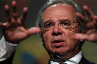 Brazil's Economy Minister Paulo Guedes gestures as he speaks during Brazil Investment Forum in Sao Paulo