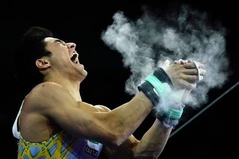 Brazil's Arthur Mariano reacts after performing to win the horizontal bar apparatus finals at the FIG Artistic Gymnastics World Championships at the Hanns-Martin-Schleyer-Halle in Stuttgart, southern Germany, on October 13, 2019. (Photo by Lionel BONAVENTURE / AFP)