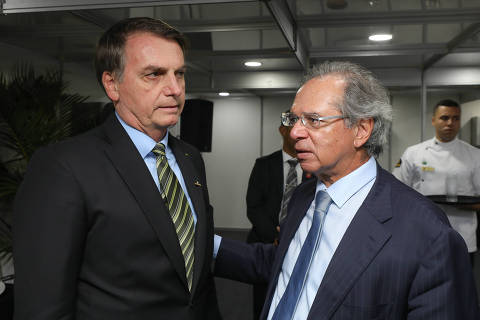 (Itaguaí - RJ, 11/10/2019) Presidente da República Jair Bolsonaro, conversa com o Ministro de Economia, Paulo Guedes. Foto: Marcos Corrêa/PR