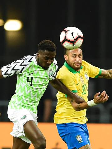 """CORRECTION - Brazil's forward Neymar (R) fight for the ball with Nigeria's midfielder Wilfred Ndidi  during an international friendly football match between Brazil and Nigeria at the National Stadium in Singapore on October 13, 2019. (Photo by Roslan RAHMAN / AFP) / """"The erroneous mention[s] appearing in the metadata of this photo by Roslan RAHMAN has been modified in AFP systems in the following manner: [October 13] instead of [October 12]. Please immediately remove the erroneous mention[s] from all your online services and delete it (them) from your servers. If you have been authorized by AFP to distribute it (them) to third parties, please ensure that the same actions are carried out by them. Failure to promptly comply with these instructions will entail liability on your part for any continued or post notification usage. Therefore we thank you very much for all your attention and prompt action. We are sorry for the inconvenience this notification may cause and remain at your disposal for any further information you may require."""""""