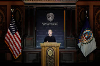 Facebook Chairman and CEO Mark Zuckerberg addresses the audience in Georgetown University's Institute of Politics and Public Service in Washington