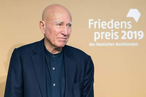 Sebastiao Salgado, Brazilian photographer and this year's winner of the Peace Prize of the German book traders association is pictured during a press conference at the Frankfurt book fair 2019 in Frankfurt am Main, Germany, on October 18, 2019. - The Frankfurt book fair is the world's largest publishing event, with this year Norway as honorary guest of the fair running from October 16 to 20, 2019. (Photo by Silas Stein / dpa / AFP) / Germany OUT ORG XMIT: 90-011443