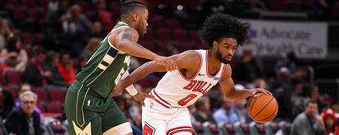Oct 7, 2019; Chicago, IL, USA; Chicago Bulls guard Coby White (0) dribbles the ball around Milwaukee Bucks guard Frank Mason III (15) during the second half at the United Center. Mandatory Credit: Mike DiNovo-USA TODAY Sports ORG XMIT: USATSI-406543