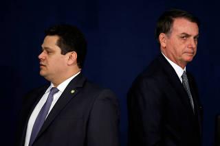 Brazil's President Bolsonaro looks on near the President of the Senate Alcolumbre during the handover ceremony for the new Prosecutor-General Aras in Brasilia