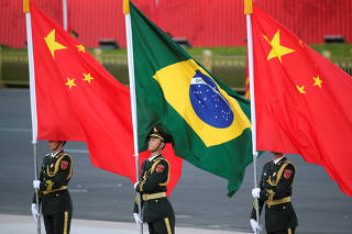 Chinese President Xi Jinping and Brazilian President Jair Bolsonaro attend a welcoming ceremony in Beijing