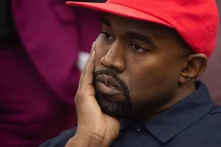 Trump hosts lunch for the rapper Kanye West, with the pair due to discuss issues including gun violence and prison reform
