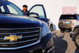 A striking union auto worker leaves the UAW Local 659 after picking up his strike check outside the General Motors Flint Truck Assembly in Flint
