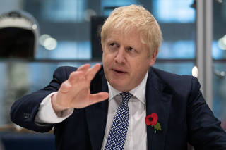 Britain's PM Boris Johnson visits Metropolitan Police training college in Hendon, London