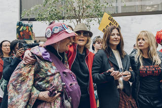Jane Fonda, center, Catherine Keener and Rosanna Arquette, right, protest climate change at the Hart Senate Office Building on Capitol Hill in Washington, Nov. 1, 2019. (Jared Soares/The New York Times)