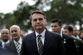 Brazil's President Jair Bolsonaro leaves the Planalto Palace to deliver the economic reform package to National Congress, in Brasilia