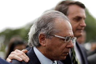 Brazil's President Jair Bolsonaro and Brazil's Economy Minister Paulo Guedes leave the Planalto Palace to deliver the economic reform package to National Congress, in Brasilia