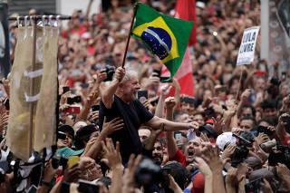 Former Brazilian President Luiz Inacio Lula da Silva waves the Brazilian flag after being released from prison, in Sao Bernardo do Campo