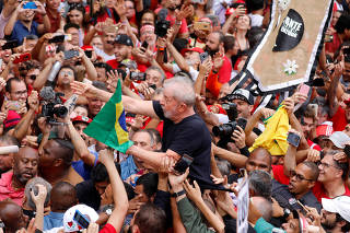 Former Brazilian President Luiz Inacio Lula da Silva greets his supporters after being released from prison, in Sao Bernardo do Campo