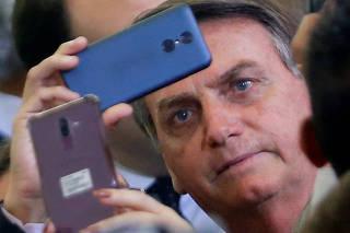 Brazil's President Jair Bolsonaro looks on during a ceremony at the Planalto Palace in Brasilia