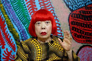 Japanese avant-garde artist Kusama speaks to journalists at her studio in Tokyo