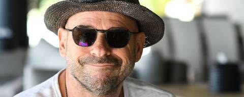 (FILES) In this file photo taken on July 19, 2019 Guy Laliberte, founder of the Cirque du Soleil and owner of the private island of Nukutepipi, in the French Polynesia archipelago of Tuamotu, poses in the resort. - The billionaire founder of global acrobatic troupe Cirque du Soleil, Guy Laliberte, has been detained in French Polynesia on suspicion of growing cannabis on his private island in the South Pacific, authorities said. The Canadian entrepreneur turned himself in to police and was due to appear before a judge later on November 13, 2019, prosecutors and reports said. (Photo by Mike LEYRAL / AFP)