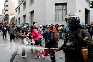 Clashes between supporters of former Bolivian President Evo Morales and members of the security forces, in La Paz