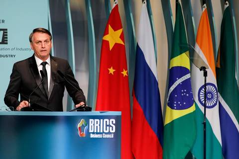 Brazil's President Jair Bolsonaro speaks during the BRICS Business Council prior to the 11th edition of the BRICS Summit, in Brasilia, on November 13, 2019. - Bolsonaro walked a diplomatic tightrope, as he seeks to boost ties with Beijing and avoid upsetting key ally Donald Trump, on the eve of a summit with their BRICS counterparts from Russia, India and South Africa. (Photo by Sergio LIMA / AFP) ORG XMIT: SLI