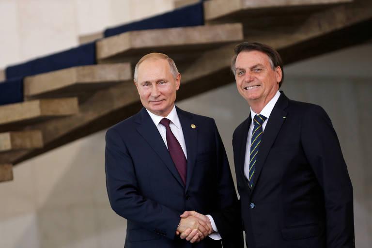 Os presidentes de Rússia, Vladimir Putin, e Brasil, Jair Bolsonaro, durante encontro do Brics em Brasília