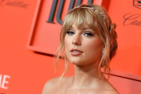 (FILES) In this file photo Singer/songwriter Taylor Swift arrives on the red carpet for the Time 100 Gala at the Lincoln Center in New York on April 23, 2019. - Unleash the Swifties: Taylor Swift has tapped her millions-strong social media fan base to pressure the heads of her former label, who she says are wielding