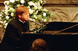 FILE PHOTO: Elton John sings a rewritten version of his song 'Candle in the wind' as a tribute to Diana, Princess of Wales at her funeral in London's Westminster Abbey