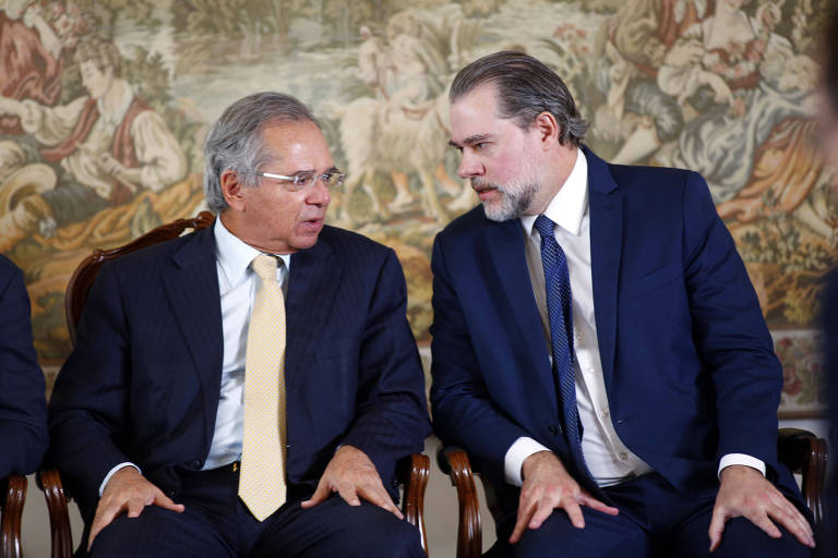 Os ministros Paulo Guedes (Economia) e Dias Toffoli (STF), em evento em Brasília, em agosto