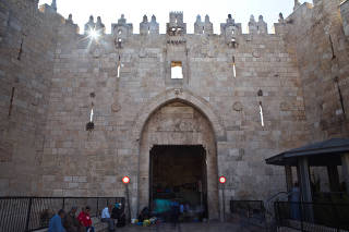 People are seen near Damascus Gate in Jerusalem's Old City
