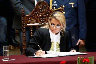 Bolivia's interim President Jeanine Anez enacts the law for general election at the national congress
