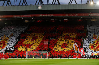 FILE PHOTO: General view of players and fans during a minutes applause in memory of the Hillsborough disaster victims