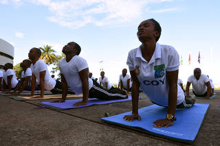 Soldiers with theÊRepublic of Sierra Leone Armed Forces (RSLAF) participate in a weeklyÊyoga training at the country's military headquarters in Freetown