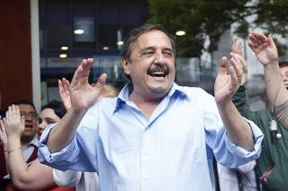 Presidential candidate Ricardo Alfonsin from the Union Para el Desarrollo Social Party smiles as he campaigns in Buenos Aires